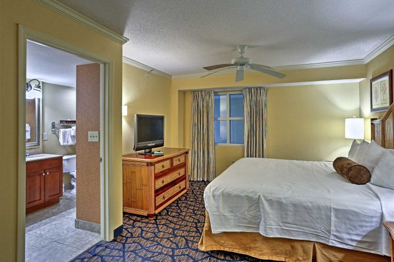 The master suite boasts a flat-screen cable TV and en-suite bathroom.