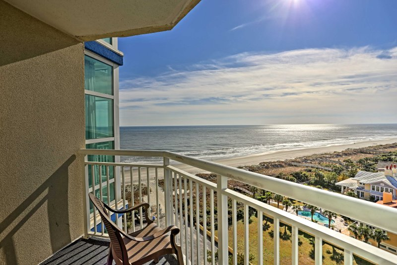 After a long day at the beach, watch the sunset from your furnished balcony.