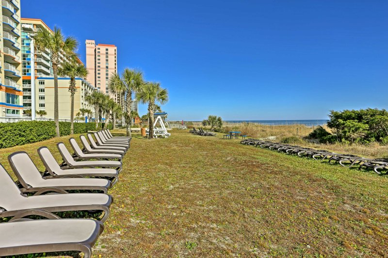 Don't like walking on hot pavers? Relax in the grassy lounge area with ocean views.