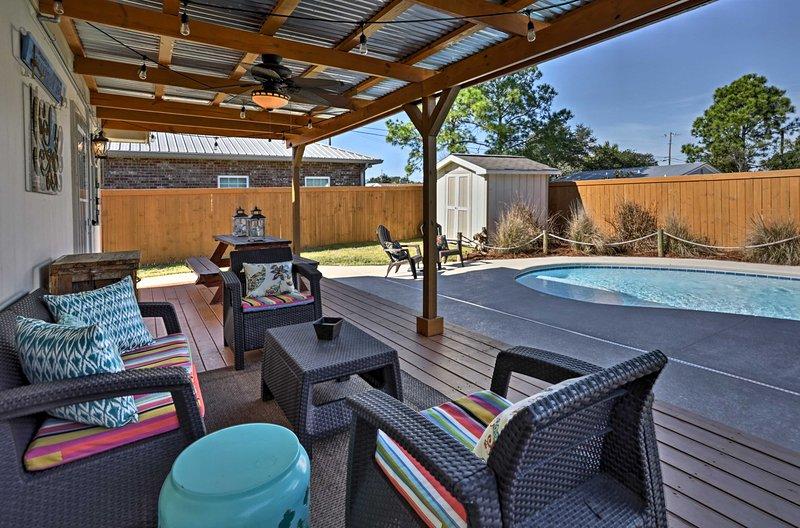 Potrete sorseggiare il vostro cocktail preferito mentre vi rilassate sul patio coperto.