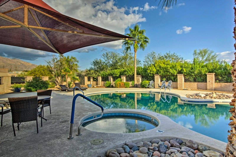 Take full advantage of the clubhouse, which includes a pristine community pool when you stay at this 3-bedroom, 2-bathroom vacation rental home in Tucson.