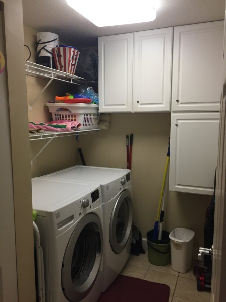 Full Size Front Load washer and Dryer in their own room