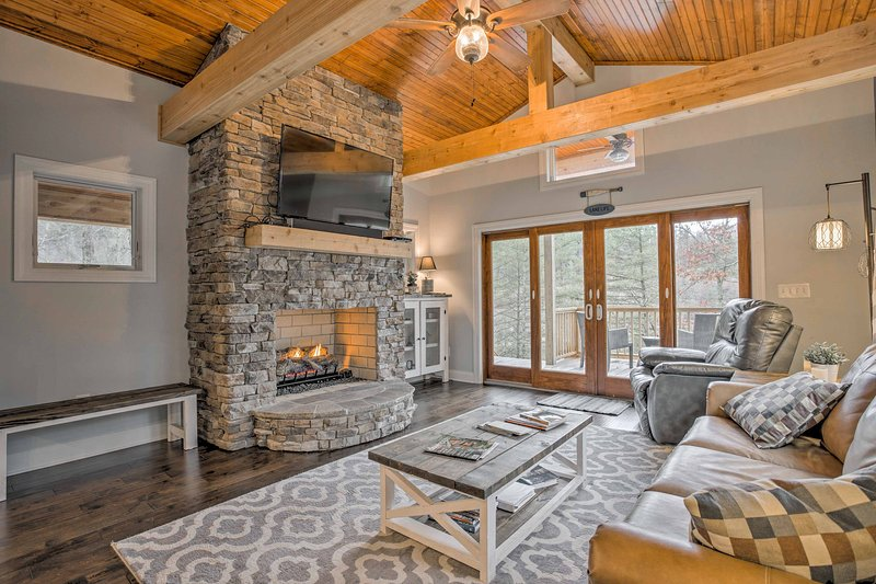 The 1,500-square-foot interior offers rustic elegance and modern amenities.