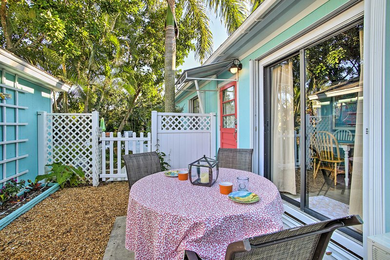 This tropical bungalow includes a charming outdoor living space.