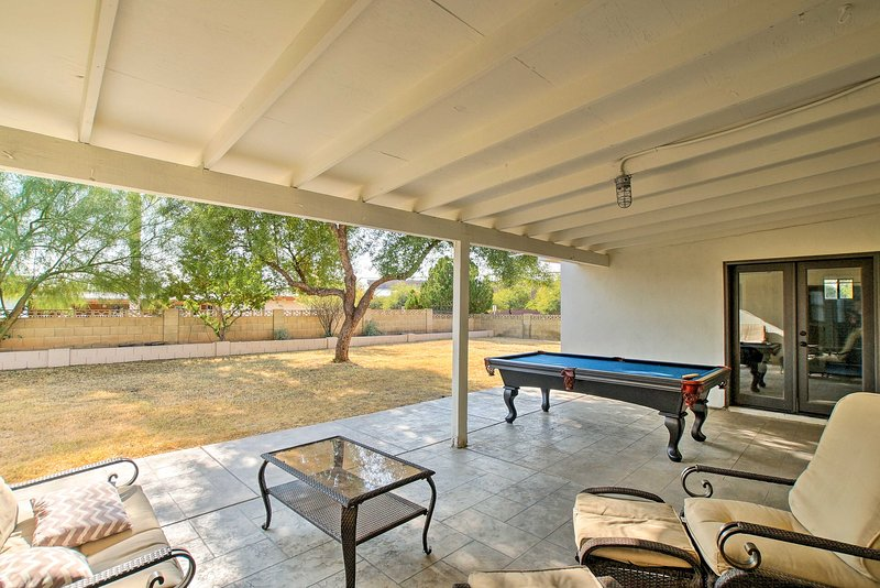 Outside you'll find a wonderful patio space, hot tub, pool table and fire pit!