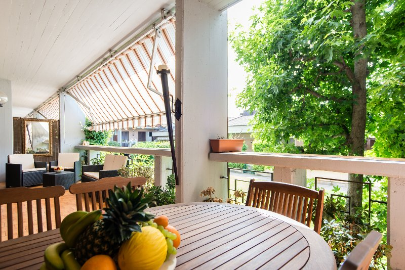 Spacious terrace overlooking garden and pool area