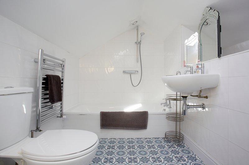 House bathroom with bath and shower
