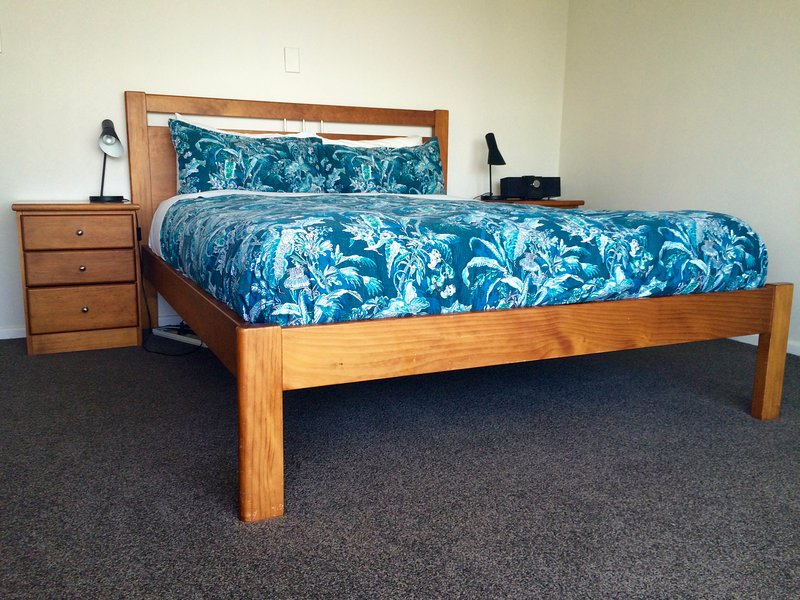 Main bedroom with super comfortable queen bed and high quality mattress!