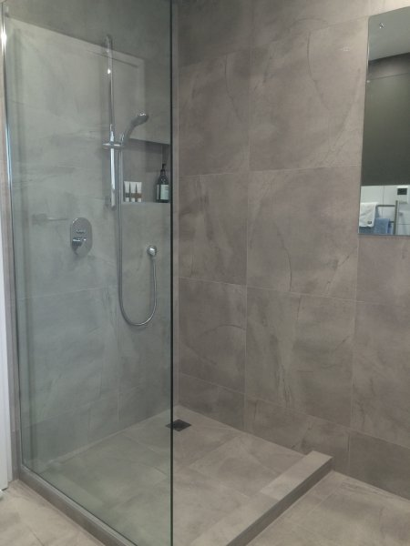 Large European style shower, fully tiled. Heated flooring in bathroom