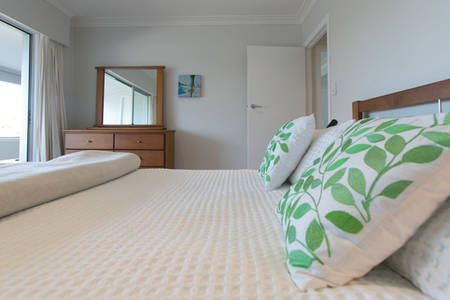 Main bedroom, spacious and light. Has lovely views out to the ocean and over the palm trees.