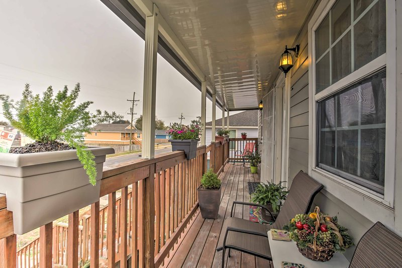 The home features a covered front and back porch where you can sip your coffee.