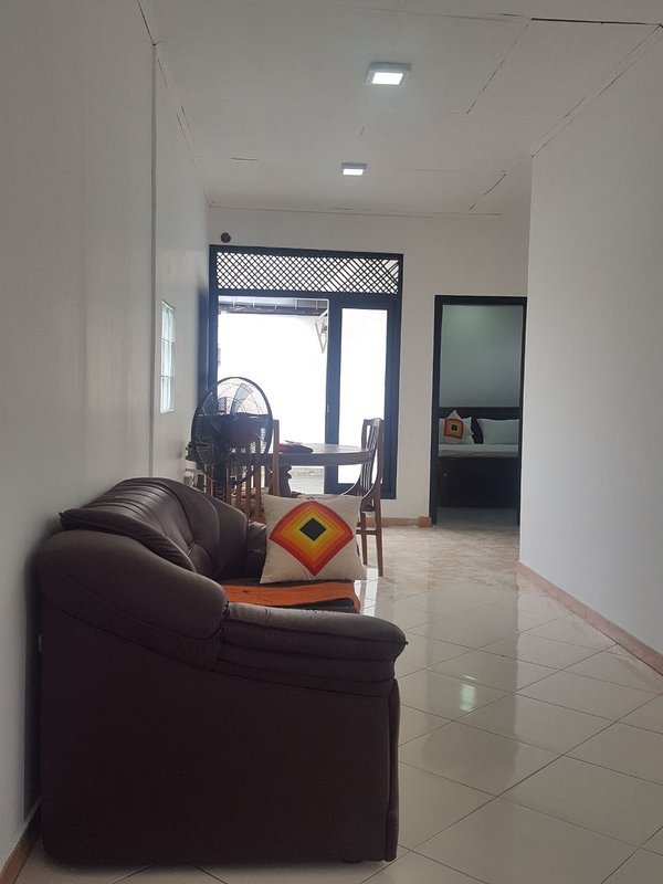 The Sofa,Fan, Dining Table, Washing Maching, City View Balcony and Air-Conditioned Bed room. -LIVING