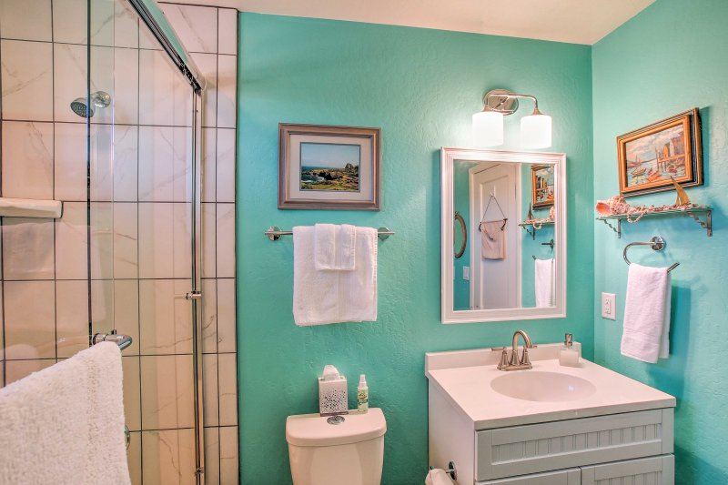 Wash up in the shower/tub combo and single vanity featured in the bathroom.