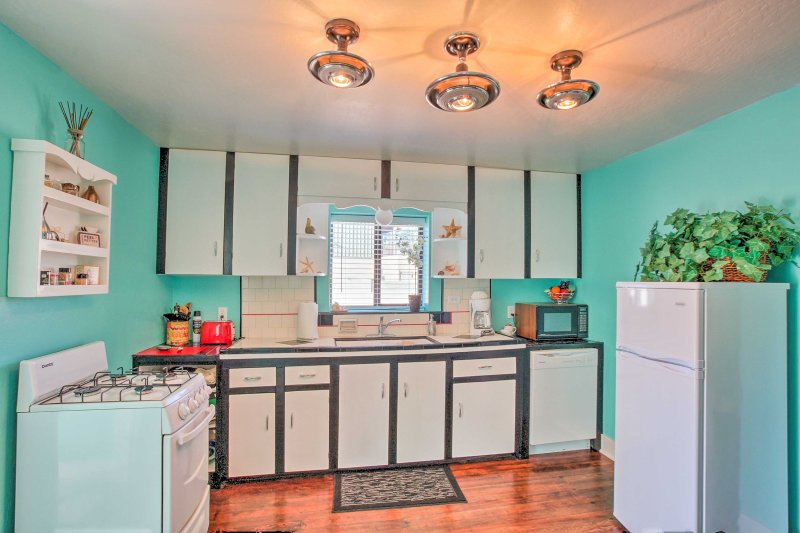 This fully equipped kitchen adds to the country charm.
