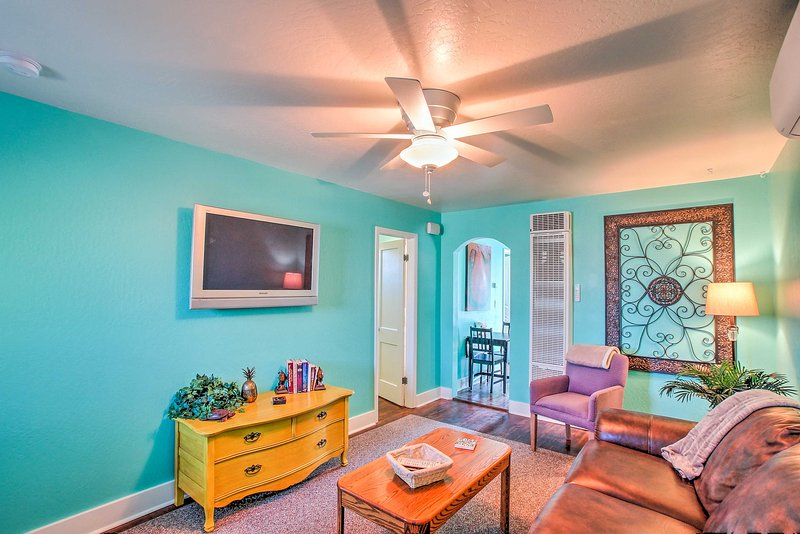 Vibrant decor and turquoise walls highlights this Prescott vacation rental cottage!