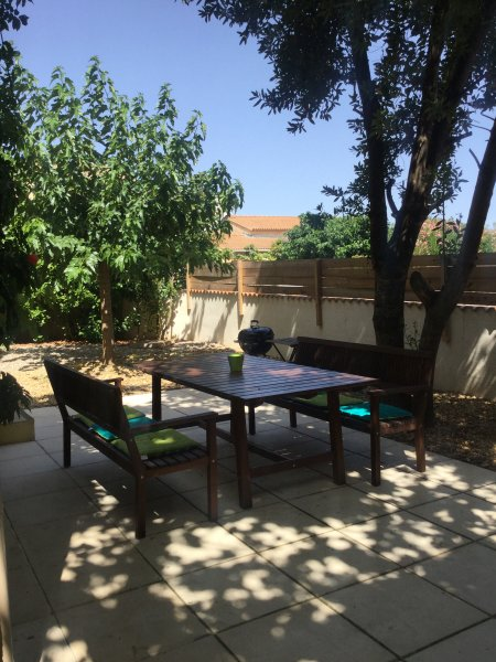 Outdoor dining, kettle BBQ and table