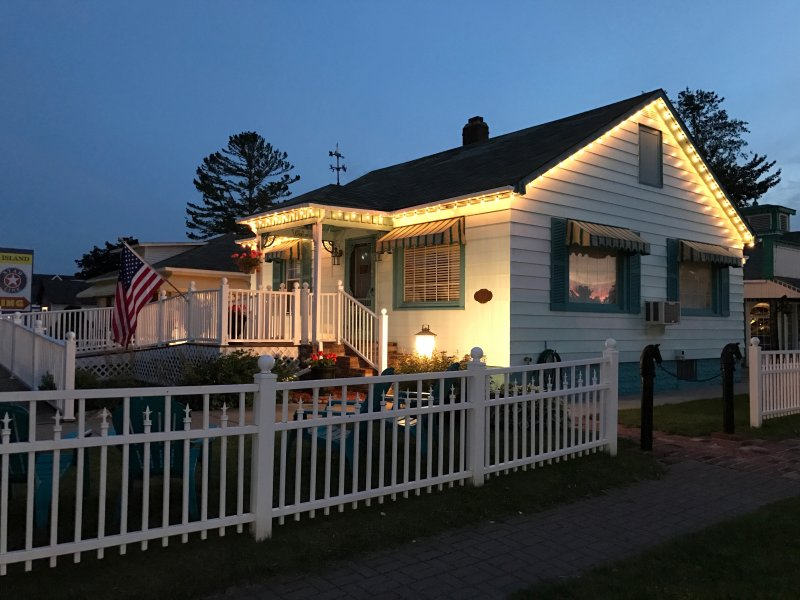 Huron Breeze Cottage at night with lights