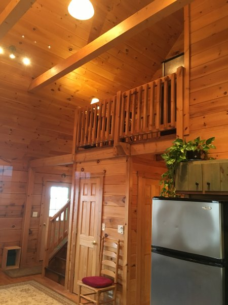 Loft with work station and entrance to large upstairs bedroom, sleeps 6.