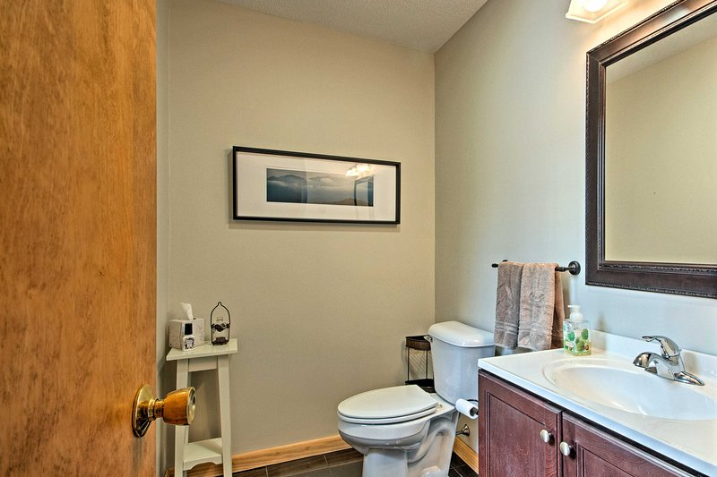 A half bathroom is located next to the living room.