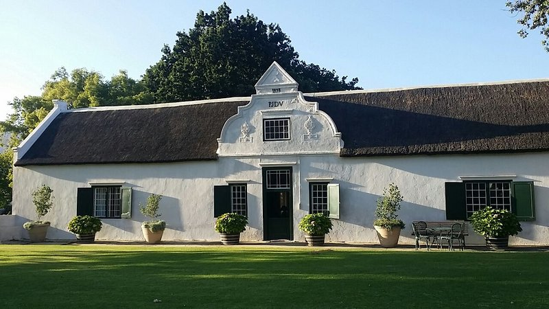 Historical Cape Dutch home. Build 1793, set in well-cared gardens.