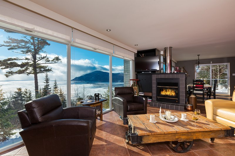 Open concept living, dining and kitchen with breathtaking views from all rooms