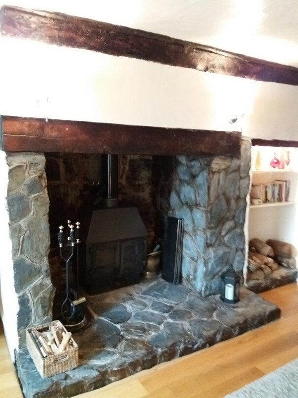 Woodburner  and inglenook fireplace. We leave you logs for your first fire