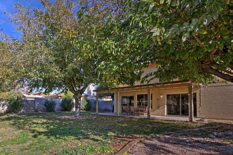 With a spacious backyard and covered patio, this 4-bedroom, 2.5-bathroom home is great for families seeking a fun vacation together.
