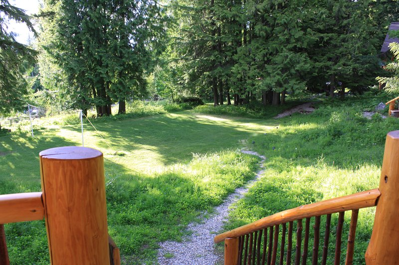 deck opens onto lawn for playing games, relaxing and a fire pit .
