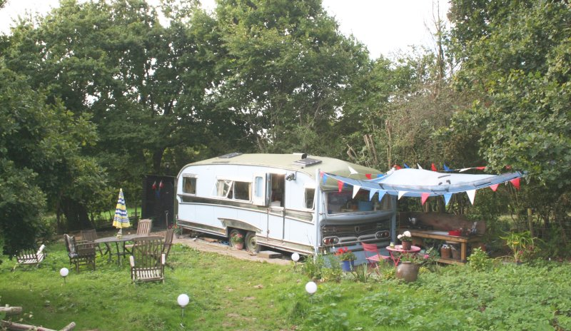 The Star Showman's caravan. 48ft long, solar outside lighting. Orchard setting.