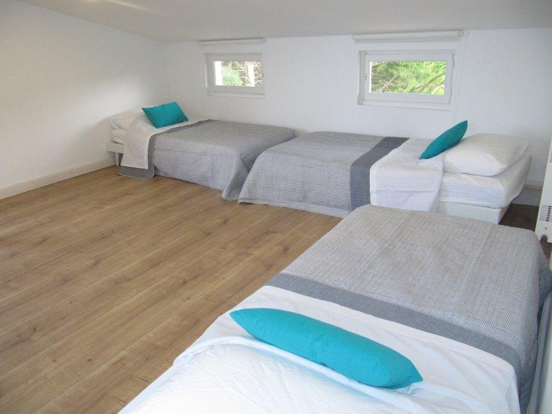 Top floor single beds, four beds per room