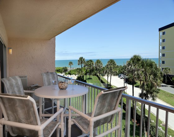 Ocean view from the balcony with high top seating