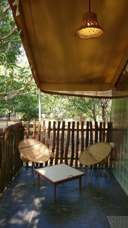 'Patio Sitout' outside GlampingTents-Paw Haven offers 'Paw-Cation' A 'Glamping' vacation in nature.