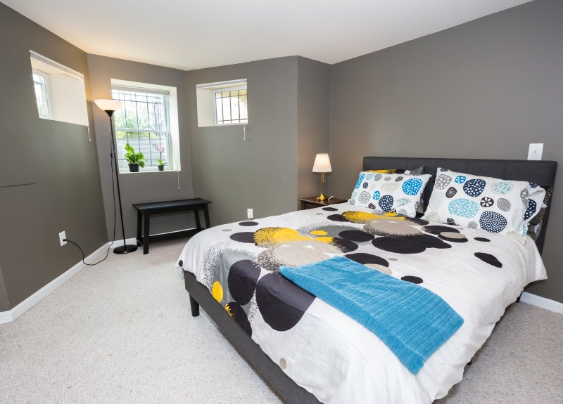 Spacious and cozy bedroom with queen bed