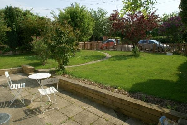 Front garden l;aid to lawn with parking for two cars