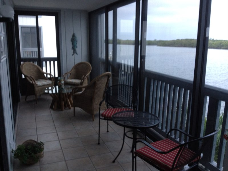 Enclosed patio overlooking canal