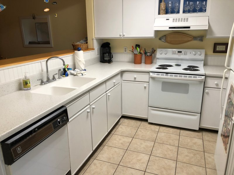 It features tile flooring and plenty of counter space.