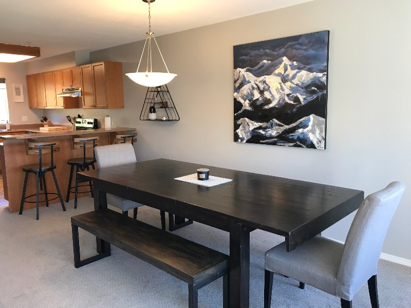 Open floor plan, large table that seats 10, kitchen bar counter