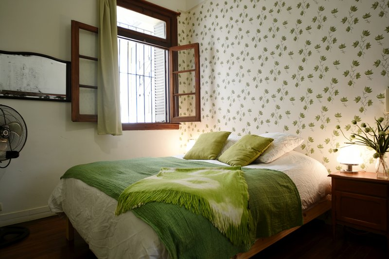 The bedroom is on the opposite side of the apartment and has a queen mattress.