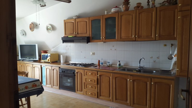 Bellavista kitchen with table and balcony access with great view table