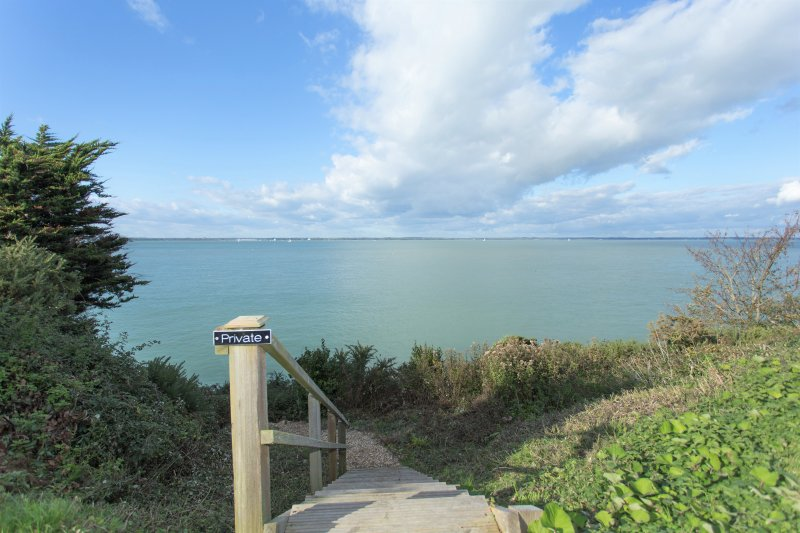 Private steps down to the water and coastal path into Yarmouth. Located opposite the property.