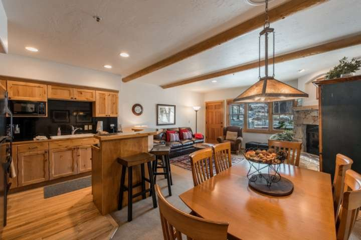 Dining Table for up to 6 Guests and Breakfast Bar Seating for 3, Wood Flooring in the Kitchen, Open concept main floor.