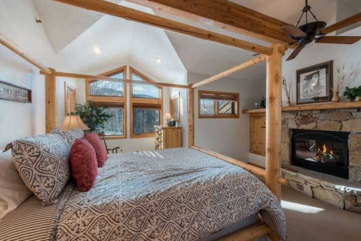 Master Bedroom with queen four-poster bed and gas fireplace.