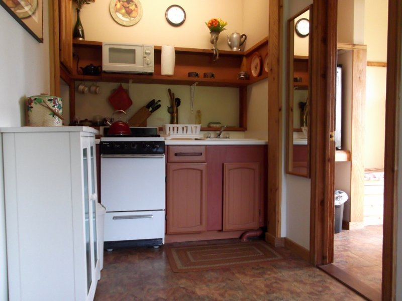 A snug, fully-equipped kitchen.