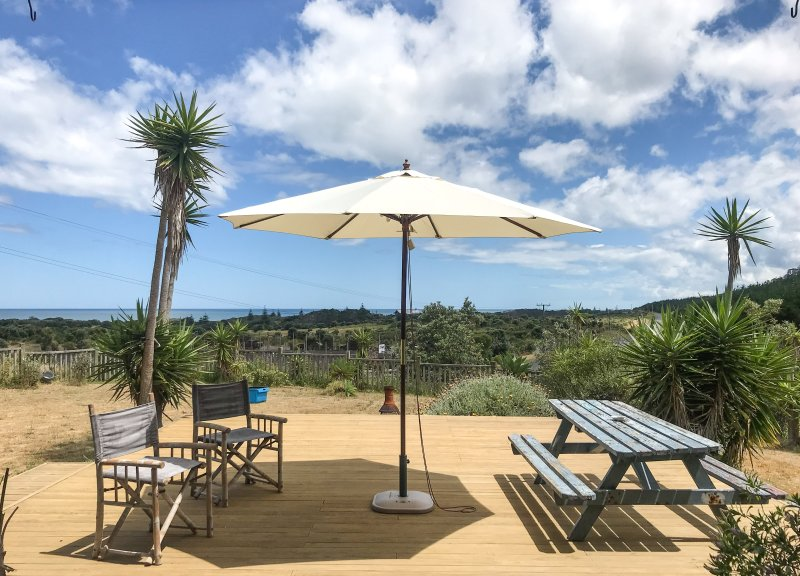 Sunny deck with views over golf course and Tasman Sea