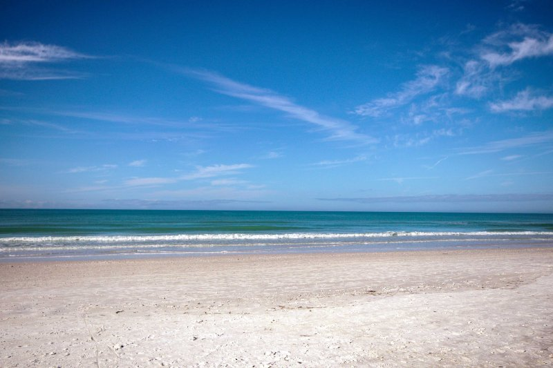 Sink your toes into the white sand of Crescent Beach just a 5-minute walk away!