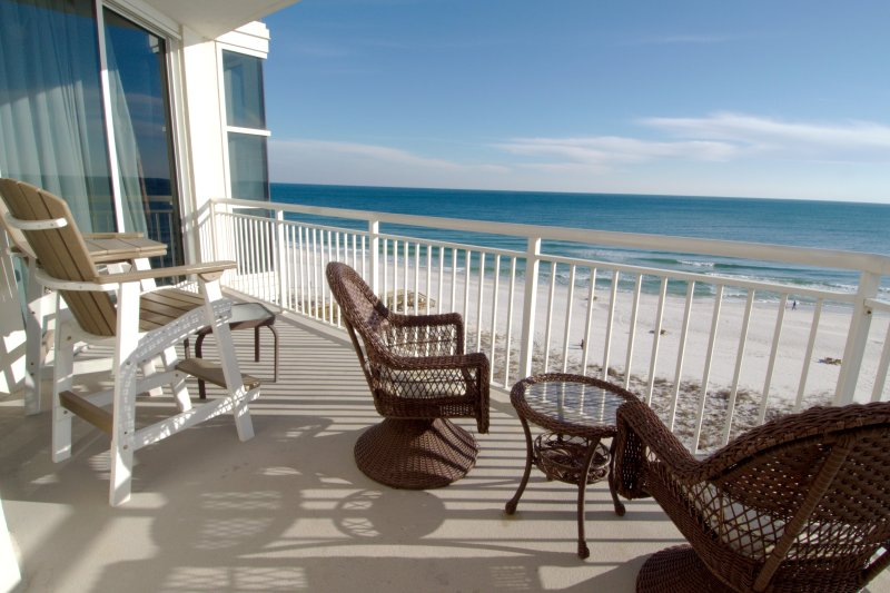 Balcony with outdoor furniture and ocean view