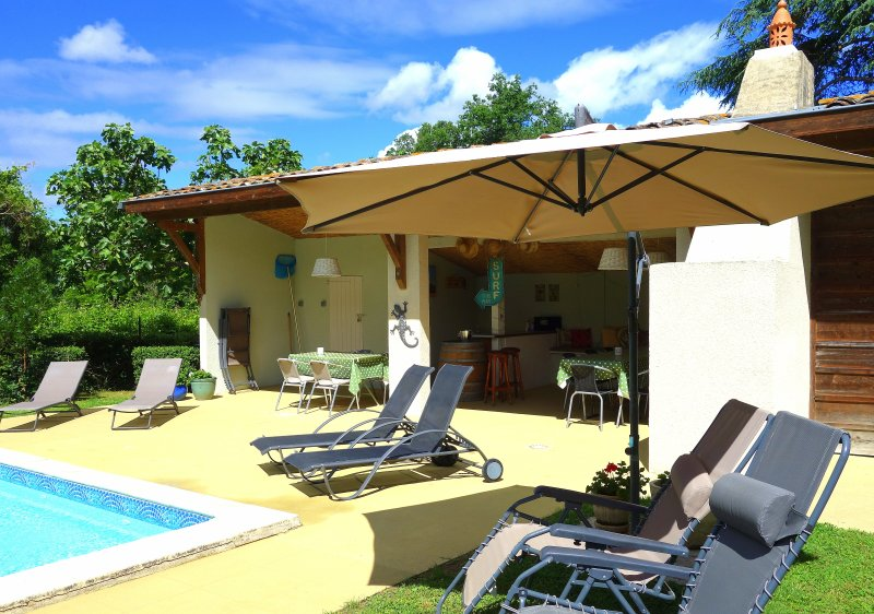 Poolhouse offers shade and comfortable seating. Fridges for a cold beer!