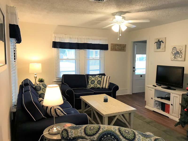 Recently updated living room with new floors, new window treatments and fresh paint!  Includes a flat-screen TV, DVD/BluRay player, books, and games for the whole family.