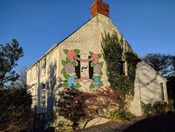 Mural on side of cottage.