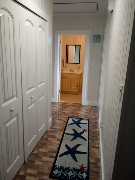 Hallway with view to guest bathroom